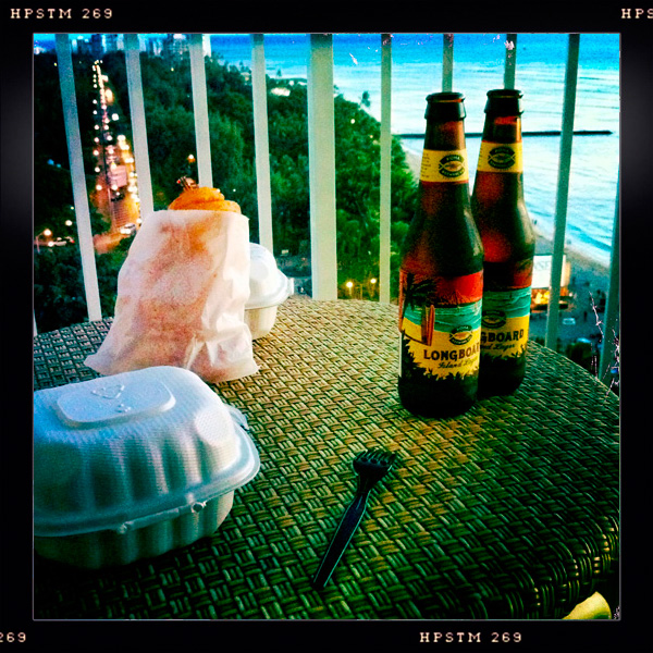 Two Cheese Burgers and Onion Rings from Teddy's Bigger Burgers, and a couple of Longboard Beers from Kona Brewing, some warm breezes and a great view. The perfect evening in Waikiki, Honolulu, Hawaii
