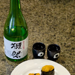Fresh Uni sushi and Dassai 50 sake - served
